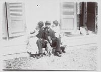 Pierre Bonnard assis sur le seuil de sa maison avec Renee, Charles, Jean et Robert