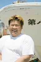 笑顔の漁師のポートレイト