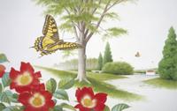 つるバラの上を飛翔するキアゲハ