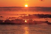 けあらしと朝焼けの流氷