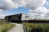 View of boardwalk and birdwatching hide in marshland, Rainha