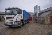Scania lorry delivering feed to farm, Northumberland, Englan