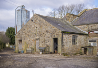 Farmyard with stone buildings and metal feed bin, Chipping,
