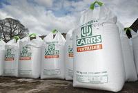 600kg bags of nitrogen fertiliser stored on farmyard, Cumbri