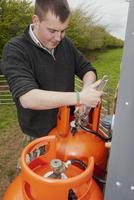 Gamebird farming, gamekeeper altering heating levels on prop 32259008610| 写真素材・ストックフォト・画像・イラスト素材|アマナイメージズ