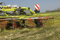 Claas grass rake, rowing grass up in silage field, Northumbe