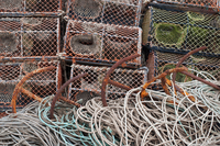 Crab fishing pots, rusty anchors and ropes, Cley Beach, Cley