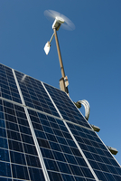 Combination of solar panels and wind turbine, harnessing ren