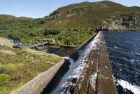 View of reservoir and dam overflow, Caban Coch Reservoir, El