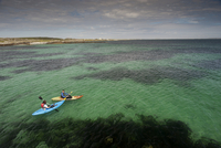 Two kayakers at sea, Hynish, Isle of Tiree, Inner Hebrides,