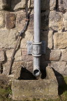 Lead downspout on wall of ruined 12th century Augustinian pr