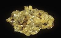 リモナイト(褐鉄鉱)の中のアダマイトの結晶。