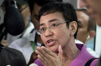 CEO of Philippine news website Rappler, Maria Ressa, gestures as she speaks to the media as she arrives at the National Bureau of Investigation (NBI) headquarters in Manila on January 22, 2018. The head of a news website threatened with closure by the government appeared before state investigators on January 22 over a defamation complaint which she decried as part of President Rodrigo Duterte's concerted attack on press freedom. / AFP PHOTO / NOEL CELIS