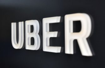 The Uber logo is seen outside the Uber Corporate Headquarters building in San Francisco, California on February 05, 2018.  The billion-dollar trial pitting Alphabet-owned autonomous driving unit Waymo against Uber started in what could be a blockbuster case between two technology giants over alleged theft of trade secrets. The San Francisco courtroom battle will take place as Waymo and Uber race to perfect self-driving cars that people could summon for rides as desired in a turn away from car ownership.  / AFP PHOTO / JOSH EDELSON