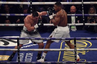 Anthony Joshua (R) of Great Britain defends against Joseph Parker (L) of New Zealand in the 12th and final round of their heavyweight unification title bout at Principality Stadium in Cardiff, March 31, 2018.  / AFP photo / Oli Scarff