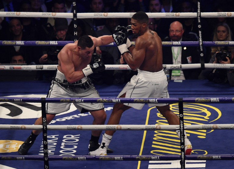 Joshua goes the distance before beating Parker in world