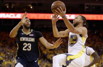 OAKLAND, CA - MAY 08: Stephen Curry #30 of the Golden State Warriors goes up for a shot on Anthony Davis #23 of the New Orleans Pelicans during Game Five of the Western Conference Semifinals of the 2018 NBA Playoffs at ORACLE Arena on May 8, 2018 in Oakland, California. NOTE TO USER: User expressly acknowledges and agrees that, by downloading and or using this photograph, User is consenting to the terms and conditions of the Getty Images License Agreement.   Ezra Shaw/Getty Images/AFP