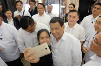 A mallgoer takes a picture with President Rodrigo Duterte, who went around Greenbelt 5 in Makati on Saturday, May 7, 2018./Bong Go/