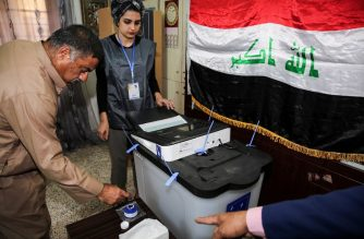 An Iraqi voter dips his finger in ink before casting his ballot at a poll station in the capital Baghdad's Karrada district on May 12, 2018, as the country votes in the first parliamentary election since declaring victory over the Islamic State (IS) group. / AFP Photo / Sabah Arar