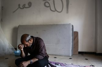 Syrian man Mehdi Haymur sits in Afrin, on May 26, 2018. Displaced from their homes in Syria's Eastern Ghouta, families sought refuge in abandoned houses in the traditionally Kurdish town of Afrin. Afrin itself had been emptied of its residents just weeks earlier, after a brutal Turkish-led offensive forced tens of thousands to flee. / AFP PHOTO / Nazeer AL-KHATIB