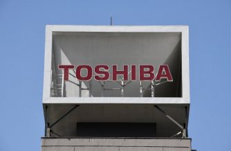 The logo of Japan's Toshiba is displayed at the company's headquarters in Tokyo on May 15, 2018.  / AFP Photo/ Kazuhiro Nogi