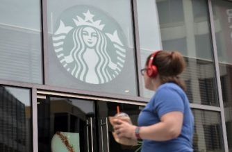 (File photo) A woman is seen in front of a Starbucks shortly before it closed early for anti-bias training on May 29, 2018 in Washington, DC. Starbucks closed more than 8,000 stores across the US Tuesday to conduct employee training on racial bias, a closely watched exercise that spotlights lingering problems of discrimination nationwide.  / AFP PHOTO / Mandel Ngan
