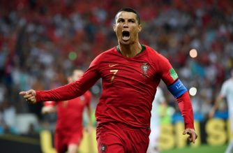 Portugal's forward Cristiano Ronaldo celebrates a goal after shooting a penalty kick during the Russia 2018 World Cup Group B football match between Portugal and Spain at the Fisht Stadium in Sochi on June 15, 2018. / AFP PHOTO / Nelson Almeida / RESTRICTED TO EDITORIAL USE - NO MOBILE PUSH ALERTS/DOWNLOADS