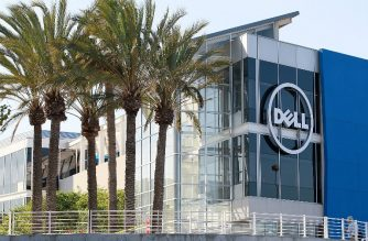 (FILES) In this file photo taken on October 19, 2011 the Dell logo is displayed on the exterior of the Dell research and development facility in Santa Clara, California.  Dell, the onetime leader in personal computers and tech industry stalwart, said July 2, 2018 it will become publicly traded five years after a contentious private equity buyout. The company announced a stock swap deal with its software subsidiary VMware that will result in a reorganized tech giant that returns to the stock market, with founder Michael Dell retaining control as chairman and chief executive.  / AFP PHOTO / GETTY IMAGES NORTH AMERICA / JUSTIN SULLIVAN