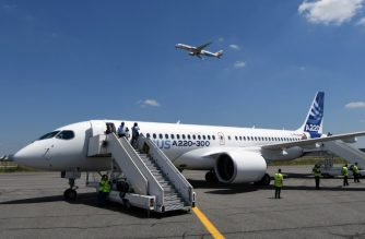 This photo taken on July 10, 2018 shows the new Airbus A220-300 parked on the tarmac on July 10, 2018 at the Airbus delivery center, in Colomiers southwestern France.    / AFP PHOTO / PASCAL PAVANI