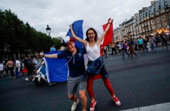People celebrate France's victory in central Paris on July 10, 2018 after the final whistle of the Russia 2018 World Cup semi-final football match between France and Belgium. / AFP PHOTO / Thomas SAMSON