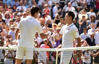 Serbia's Novak Djokovic greets Japan's Kei Nishikori after winning 6-3, 3-6, 6-2, 6-2 their men's singles quarter-finals match on the ninth day of the 2018 Wimbledon Championships at The All England Lawn Tennis Club in Wimbledon, southwest London, on July 11, 2018. / AFP PHOTO / Glyn KIRK / RESTRICTED TO EDITORIAL USE