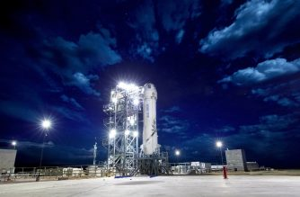 "This April 29, 2018 handout photograph obtained courtesy of Blue Origin shows the New Shepard on the launch pad the morning of Mission 8, in an undiscolosed place.  The two companies leading the pack in the pursuit of space tourism say they are just months away from their first out-of-this-world passenger flights -- though neither has set a firm date. Virgin Galactic, founded by British billionaire Richard Branson, and Blue Origin, by Amazon creator Jeff Bezos, are racing to be the first to finish their tests -- with both companies using radically different technology. / AFP PHOTO / BLUE ORIGIN / HO /  With AFP Story by Ivan COURONNE: First space tourist flights could come in 2019   == RESTRICTED TO EDITORIAL USE  / MANDATORY CREDIT:  ""AFP PHOTO /  BLUE ORIGIN"" / NO MARKETING / NO ADVERTISING CAMPAIGNS /  DISTRIBUTED AS A SERVICE TO CLIENTS  == /"