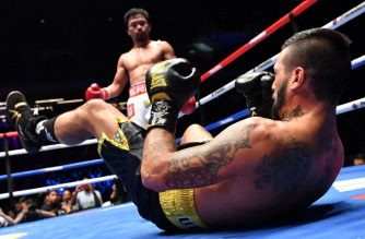 Argentina's Lucas Matthysse reacts after he was knocked down by Philippines' Manny Pacquiao during their world welterweight boxing championship bout at Axiata Arena in Kuala Lumpur on July 15, 2018. / AFP PHOTO / Mohd RASFAN