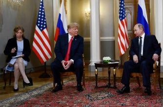 (FILES) In this file photo taken on July 16, 2018 Russian President Vladimir Putin (R) and US President Donald Trump (2L) attend a meeting in Helsinki, on July 16, 2018. / AFP Photo / Brendan Smialowski