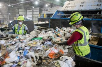 (FILES) Workers sort recycling material at the Waste Management Material Recovery Facility in Elkridge, Maryland, June 28, 2018. / AFP Photo/ Saul Loeb