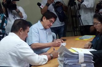 Senate President Tito Sotto (in white) and Senator Gringo Honasan subject themselves to a drug test on Monday, July 30, minutes after Sotto announced the conduct of a surprise drug test for Senate employees during the flag-raising ceremony. Meanne Corvera/Eagle News Service/