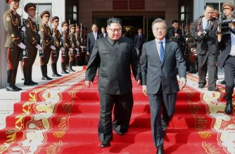 (FILES) This handout taken on May 26, 2018 and released by South Korea's presidential Blue House on May 27, 2018 shows South Korea's President Moon Jae-in (R) and North Korea's leader Kim Jong Un (L) walking together after the summit at the north side of the truce village of Panmunjom in the Demilitarized Zone (DMZ) dividing the two Koreas. / AFP Photo / The Blue House / handout