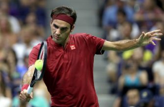 NEW YORK, NY - AUGUST 28: Roger Federer of Switzerland returns the ball during his men's singles first round match against Yoshihito Nishioka of Japan on Day Two of the 2018 US Open at the USTA Billie Jean King National Tennis Center on August 28, 2018 in the Flushing neighborhood of the Queens borough of New York City.   Matthew Stockman/Getty Images/AFP