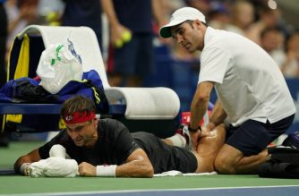David Ferrer of Spain has his leg rubbed by a trainer while playing against Rafael Nadal of Spain during their 2018 US Open men's Singles match at the USTA Billie Jean King National Tennis Center in New York on August 27, 2018. / AFP Photo / Don Emmert