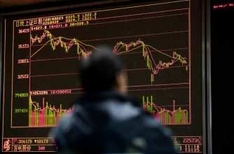 FILES: A man monitors stock price movements at a securities company in Beijing on March 23, 2018. Hong Kong and mainland Chinese stocks plunged at open on March 23 on growing fears of a global trade war after Donald Trump imposed billions of dollars of tariffs on Chinese imports and Beijing drew up a list of retaliatory measures. / AFP PHOTO / NICOLAS ASFOURI