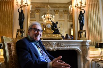 "(FILES) In this file photo taken on November 10, 2016 Argentinian composer Lalo Schifrin smiles after he was awarded Commandeur in the Order of Arts and Letters, in Paris. Argentinian composer Lalo Schifrin, best known for his ""Mission: Impossible"" theme song, is to receive an honorary Oscar along with actress Cicely Tyson and publicist Marvin Levy, the Academy said on September 5, 2018. / AFP PHOTO / Eric FEFERBERG"