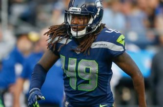 (FILES) In this file photo taken on August 9, 2018 linebacker Shaquem Griffin #49 of the Seattle Seahawks defends against the Indianapolis Colts at CenturyLink Field  in Seattle, Washington.    Shaquem Griffin is poised to write another chapter in his remarkable journey to the National Football League after the one-handed linebacker was confirmed as a starter for the Seattle Seahawks' season-opening game against Denver. Seahawks coach Pete Carroll confirmed that Griffin, who had his hand amputated as a four-year-old because of a rare birth defect, would be given his debut in Colorado after impressing in pre-season.  / AFP PHOTO / GETTY IMAGES NORTH AMERICA / OTTO GREULE JR