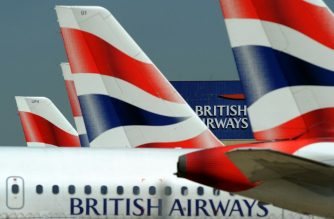 (FILES) This file picture taken on May 24, 2010 shows the British Airways logo between tailfins of aircraft parked at Heathrow Airport, west of London. British Airways said Thursday, September 6 that the personal and financial details of customers making bookings between August 21 and September 5 were stolen in a data breach on 380,000 payment cards. / AFP PHOTO / Adrian DENNIS