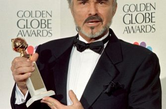 """Actor Burt Reynolds holds his Golden Globe Award for Best Supporting Actor in the drama category for his role in """"Boogie Nights"""" at the 55th Annual Golden Globe Awards at the Beverly Hilton ,18 January, in Beverly Hills, CA.     AFP PHOTO    Hal GARB/mn / AFP PHOTO / HAL GARB"""