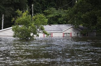 SPRING LAKE, NC - SEPTEMBER 17: Flood waters are seen around a home as the Little River over-flows its banks on September 17, 2018 in Spring Lake, North Carolina. Flood waters from the cresting rivers inundated the area after the passing of Hurricane Florence.   Joe Raedle/Getty Images/AFP