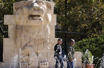 Visitors walk in front of the Lion of al-Lat, an ancient statue from the temple of the same name in Palmyra, during their visit to the national antiquities museum in the Syrian capital Damascus on October 28, 2018. - Syria reopened a wing of the capital's famed antiquities museum today after six years of closure to protect its exhibits from the civil war. (Photo by LOUAI BESHARA / AFP)