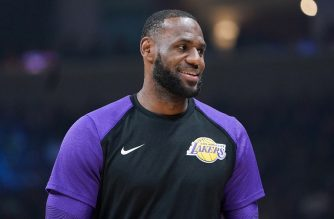 SAN JOSE, CA - OCTOBER 12: LeBron James #23 of the Los Angeles Lakers looks on smiling while there's a time out against the Golden State Warriors during the first half of their NBA preseason basketball game at SAP Center on October 12, 2018 in San Jose, California. NOTE TO USER: User expressly acknowledges and agrees that, by downloading and or using this photograph, User is consenting to the terms and conditions of the Getty Images License Agreement.   Thearon W. Henderson/Getty Images/AFP