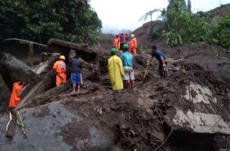 Site of the landslide in Natonin town in Mountain Province where the Department of Public Works and Highways DPWH second district engineering office building was buried under mud and rocks after typhoon Rosita's onslaught on Tuesday, Oct. 30, 2018.  (Photos courtesy DPWH Secretary Mark Villar)