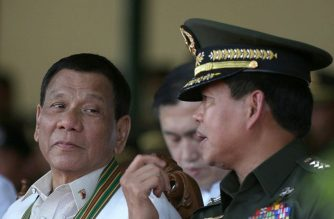 President Rodrigo Duterte speaks to Army Commander Lt. Gen. Rolando Bautista on the sidelines of the 121st founding anniversary of the Philippine Army in Taguig in March. /Presidential Photo/Toto Lozano/