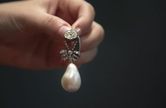 (FILES) In this file photo taken on October 11, 2018, jewelry worn by French Queen Marie Antoinette, including the pearl and diamond pendant shown here, is displayed at Sotheby's auction house in New York City. - A pearl and diamond pendant owned by Marie Antoinette before she was beheaded during the French revolution sold for $36 million at an auction on Wednesday, November 14, 2018, shattering its estimated sale price of up to $2 million.  Overall, the 10-piece collection owned by the ill-fated queen and unseen in public for two centuries exponentially beat expectations at the Geneva auction offered by Sotheby's. (Photo by Drew Angerer / GETTY IMAGES NORTH AMERICA / AFP)